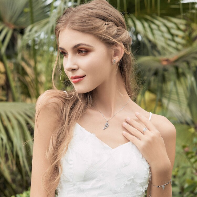 Model with Silver Feather Fairy Wings Stud Earrings